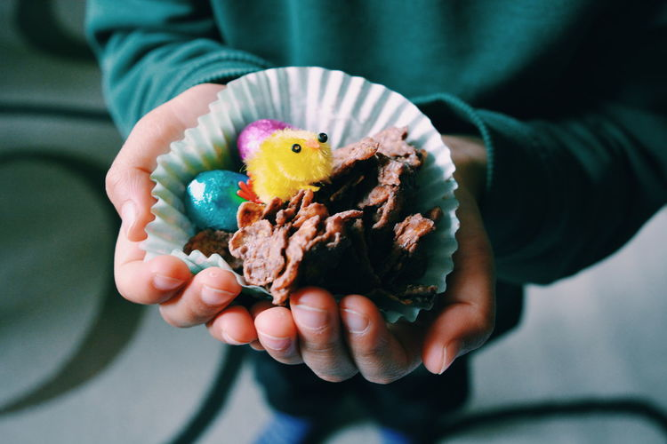 Close-Up Of Boy Holding Easter Chocolates In Hand