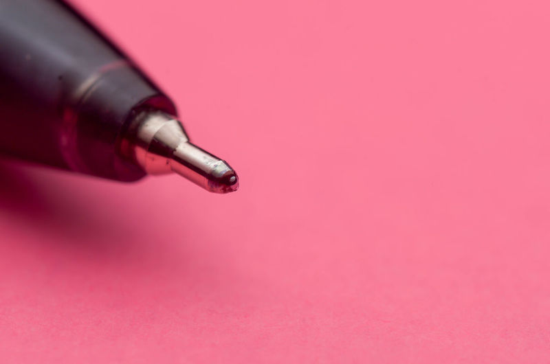 Close-up of pen on pink background