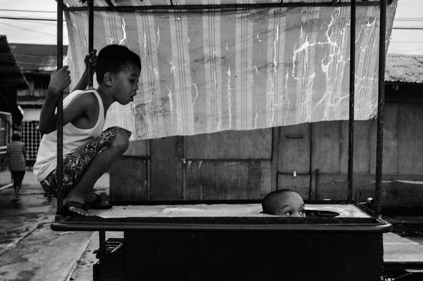Streetphotography The Human Condition Childhood Street Life Eyeem Philippines Street Photography People Street Philippines Children Everybodystreet EyeEm Lucena B&w Street Photography Streetphoto_bw B&w Blackandwhite Traveling Home For The Holidays BYOPaper! The Street Photographer - 2017 EyeEm Awards The Photojournalist - 2017 EyeEm Awards Black And White Friday Black And White Friday