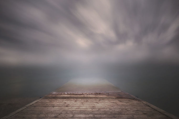 Surface level of pier against sky