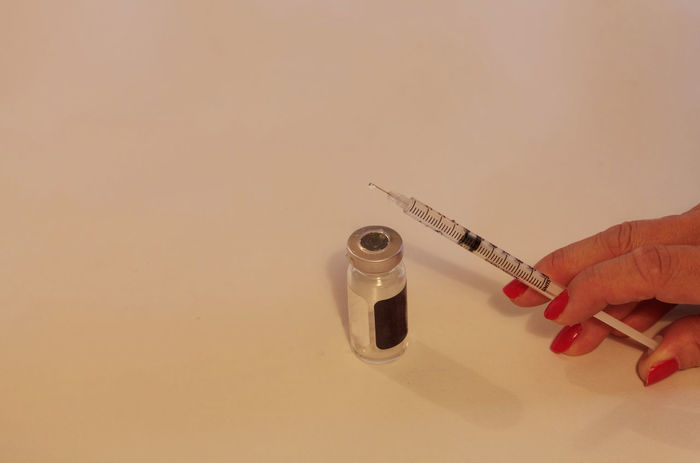 Insulin needle ready for injection in a medical doctor office in the emergency room. Day Doctor  Emergency Horizontal Hypodermic Needles Injection Insulin Insulin Syringes Medicine Needle Sharp Vaccination Vaccine