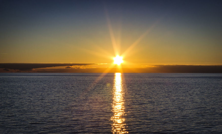 Beauty In Nature Calm Horizon Over Water Idyllic Nature No People Non-urban Scene Ocean Orange Color Outdoors Reflection Remote Rippled Scenics Sea Seascape Sky Sun Sunbeam Sunlight Sunset Tranquil Scene Tranquility Water Waterfront