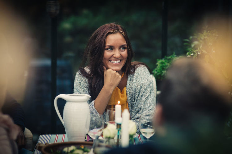 Portrait of happy woman with coffee