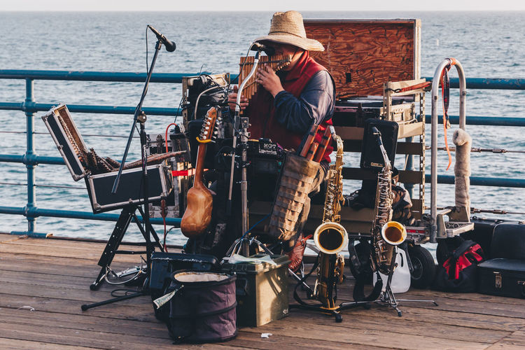 An overloaded musician plays an immense amount of instruments on Santa Monica Pier in California. - IG: @LostBoyMemoirs Streetwise Photography Streetphotography Street Photography People People Watching people and places Real People One Person Occupation Musician Musical Instrument Street Musician Busker California Santa Monica Analogue Sound The Art Of Street Photography