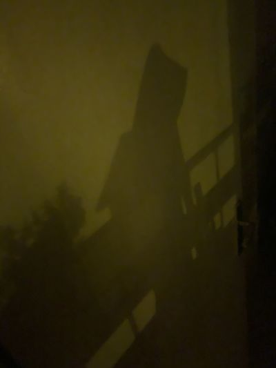 Shadow of person on wall at night