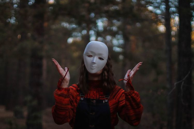 Woman Wearing Mask While Standing In Forest