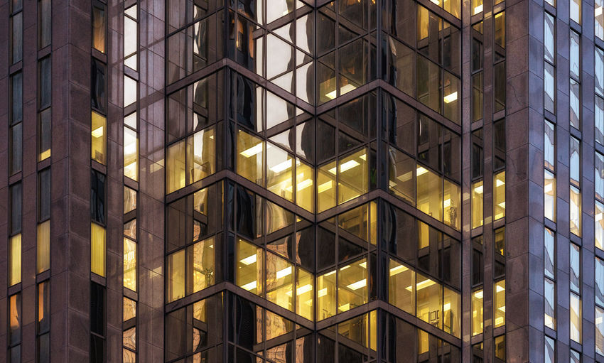 Closeup office building downtown Toronto Full Frame Building Architecture Backgrounds Built Structure Building Exterior No People Glass - Material Pattern Illuminated Window Low Angle View Modern Office Reflection Outdoors Glass Office Building Exterior Toronto Architectural Detail Working Place