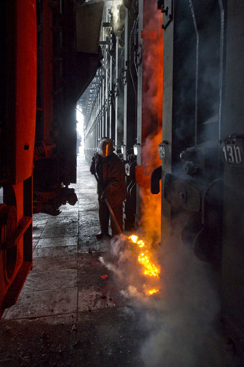Russia, Lipetsk, Novolipetsk Metallurgical Plant, coke plant, coke oven Architecture Building Building Exterior Built Structure Car City Life Empty Illuminated Land Vehicle Lighting Equipment Narrow Night Sidewalk Speed Street Street Light The Way Forward Urban Walking
