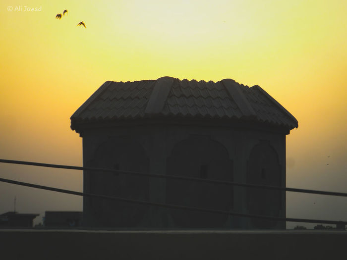 Unknown Ali Jawad Photography Building Lārkāna Photooftheday Sun Sky Sunset Orange Sky Moment Beautiful Love Ever Shine Orange Dark Bird Sunset Silhouette City Sky Architecture Building Exterior Built Structure Architectural Column Spread Wings King - Royal Person Civilization Façade Pavilion Stork Roof Palace Historic