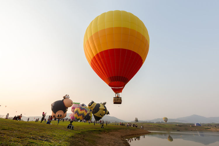 People Celebrating Ballooning Festival Against Clear Sky