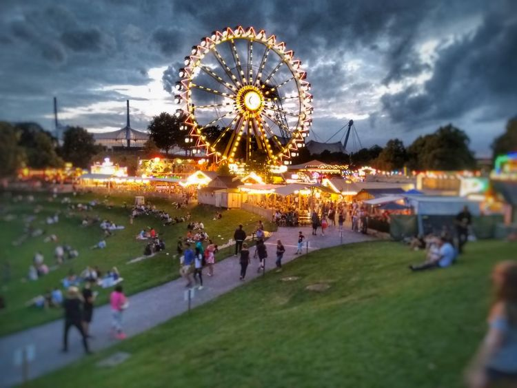 Amusement Park Arts Culture And Entertainment Leisure Activity Sky Large Group Of People Ferris Wheel Cloud - Sky Illuminated Fun Vacations Amusement Park Ride Park - Man Made Space Travel Destinations Outdoors People Night Nature Adult Adults Only Olympiaparkmünchen