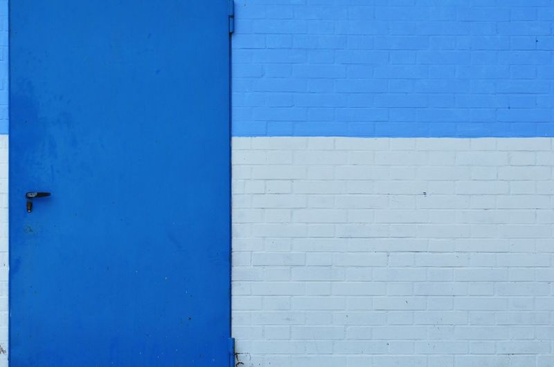 Blue Backgrounds Textured  Full Frame Wood - Material Wall - Building Feature Close-up Architecture Built Structure Weathered Whitewashed Brick Wall Cracked Door Knocker Closed Door Architectural Feature Latch Brick