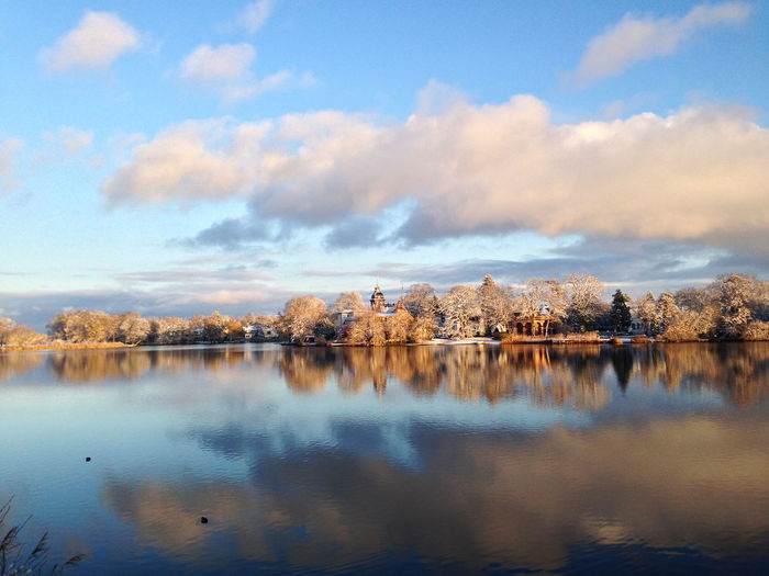 a magic winter scene in Potsdam, Germany Beauty In Nature Blue Calm Christmastime Cloud Cloud - Sky Cloudy Idyllic Lake Landscape Magic Majestic Nature No People Outdoors Reflection Sky Standing Water Symmetry Tranquil Scene Tranquility Water Winter