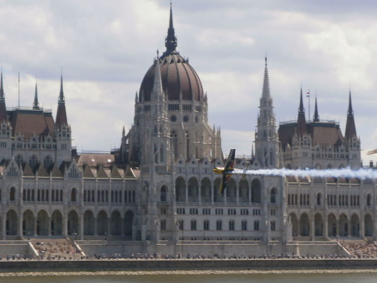 Red Bull Air Race day 2 over the Danube with the Parliament building in the backgound, in Budapest, Hungary. Airplane Architecture Budapest Building Exterior Competitive Sport Danube Danube In Budapest Hungary MyCity❤️ Parliament Building Parliament Building, Budapest Red Bull Air Race Speed Travel Destinations