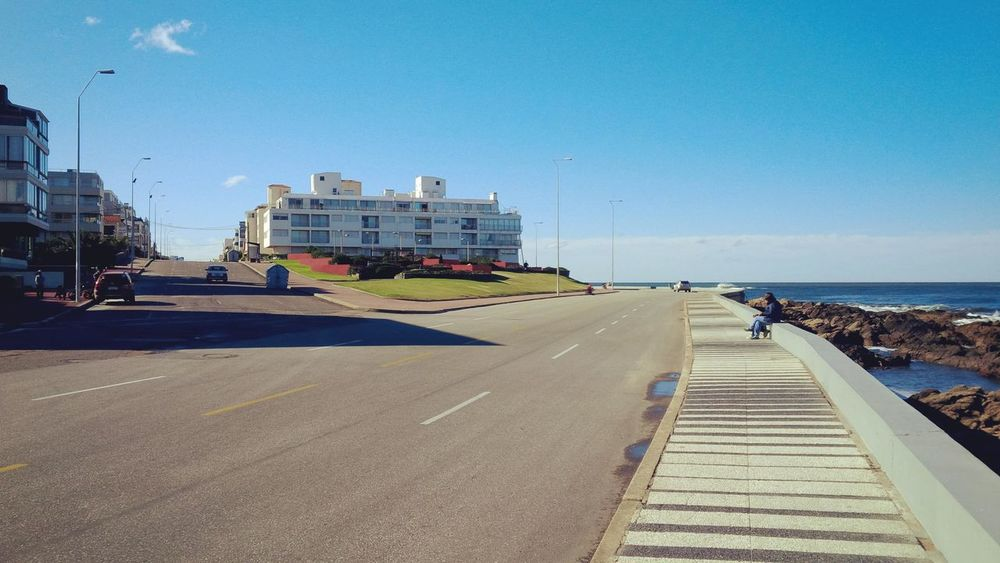 Punta del Este. July 2014. By Andrés Bentancourt Architecture Blue Built Structure City Day Diminishing Perspective Empty Horizon Over Water Nature No People Outdoors Promenade Punta Del Este Road Sea Sky The Way Forward Uruguay Vanishing Point