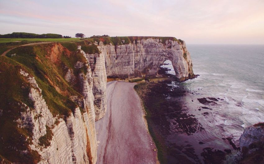 High Angle View Of Rocky Cliff By Sea At Etretat