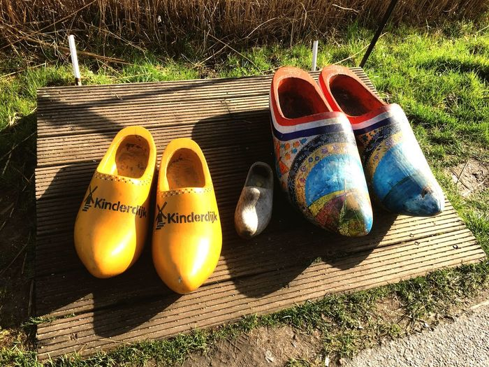Sunlight Pair Shoe High Angle View Grass Shadow Outdoors Day No People Close-up Wooden Shoes