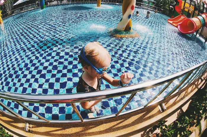 Boys Child Childhood Day Enjoyment High Angle View Innocence Leisure Activity Lifestyles Males  Men Nature One Person Outdoors Pool Real People Swimming Pool Water Women