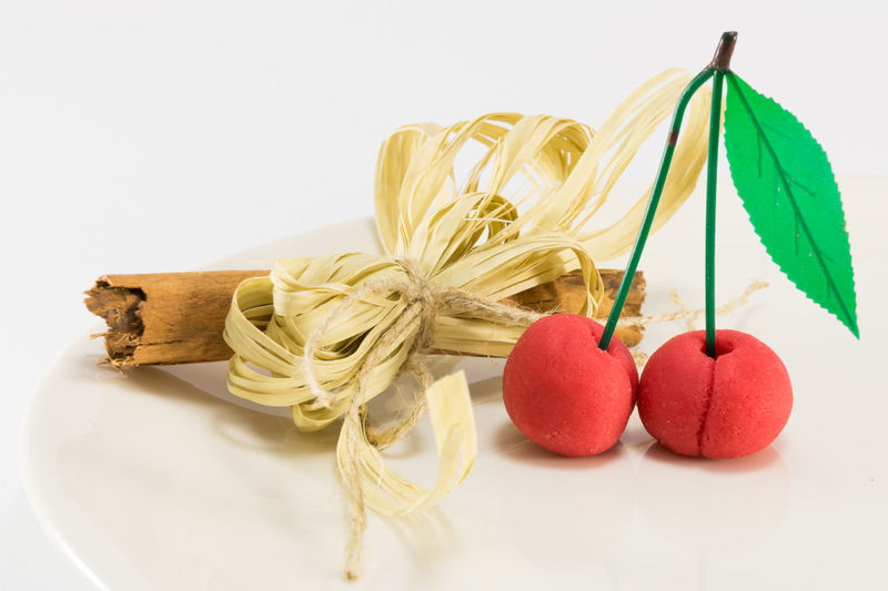 Close-up Copy Space Food Food And Drink Freshness Fruit Group Of Objects Healthy Eating Indoors  Marzipan Fruits No People Pasta Red Spaghetti Still Life String Studio Shot Table Tied Up Wellbeing White Background Wood - Material