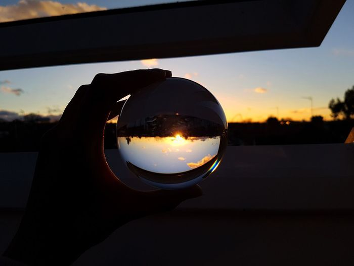 Sunset through a glass ball. Sunset Reflection Water Sky Silhouette Nature No People Close-up Outdoors Landscape Scenics Day Lensball Crystal Ball London Red Coloursplash Eyesight Multi Colored EyeEm Best Shots LONDON❤ Illuminated EyeEm Gallery Beauty In Nature