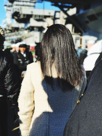 waiting Navy Pier Crowd Real People Women Black Hair Lifestyles Long Hair Sunlight One Person Focus On Foreground Warm Clothing Leisure Activity Day Close-up Outdoors The Photojournalist