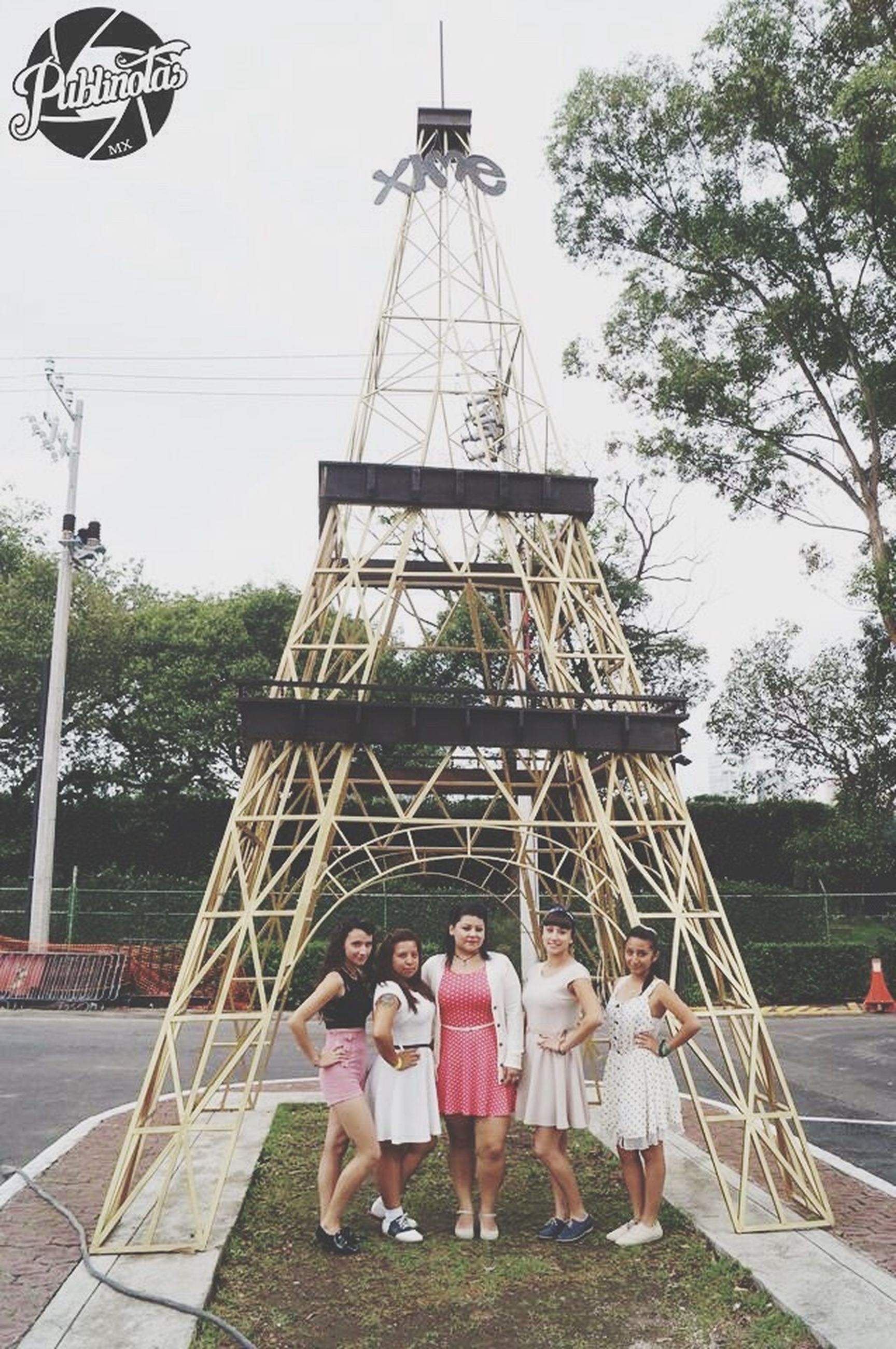 togetherness, childhood, person, girls, tower, tree, casual clothing, day, eiffel tower, relaxation, outdoors, culture, single mother, sky, amusement park