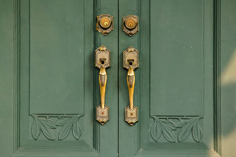 Door Handles Old brass on the green door Used to close or open the door Door Handle Brass Front Old Antique Gold Vintage Wooden Lock Entrance Metal Wood Doorknob Design Home Background Knob House White Open Decoration Architecture Close Style Gate Closeup Classic Texture Ancient Security Isolated Interior Golden Detail Ornate Doorway Modern Decorative Traditional Iron Keyhole Brown Luxury Retro Building Entry Shiny Grunge Safety
