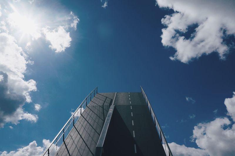 Low angle view of drawbridge against sky