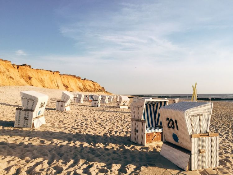 Cloud - Sky Sand Built Structure Land Nature Beach Sunlight Hooded Beach Chair Outdoors Travel Destinations Travel Sea No People