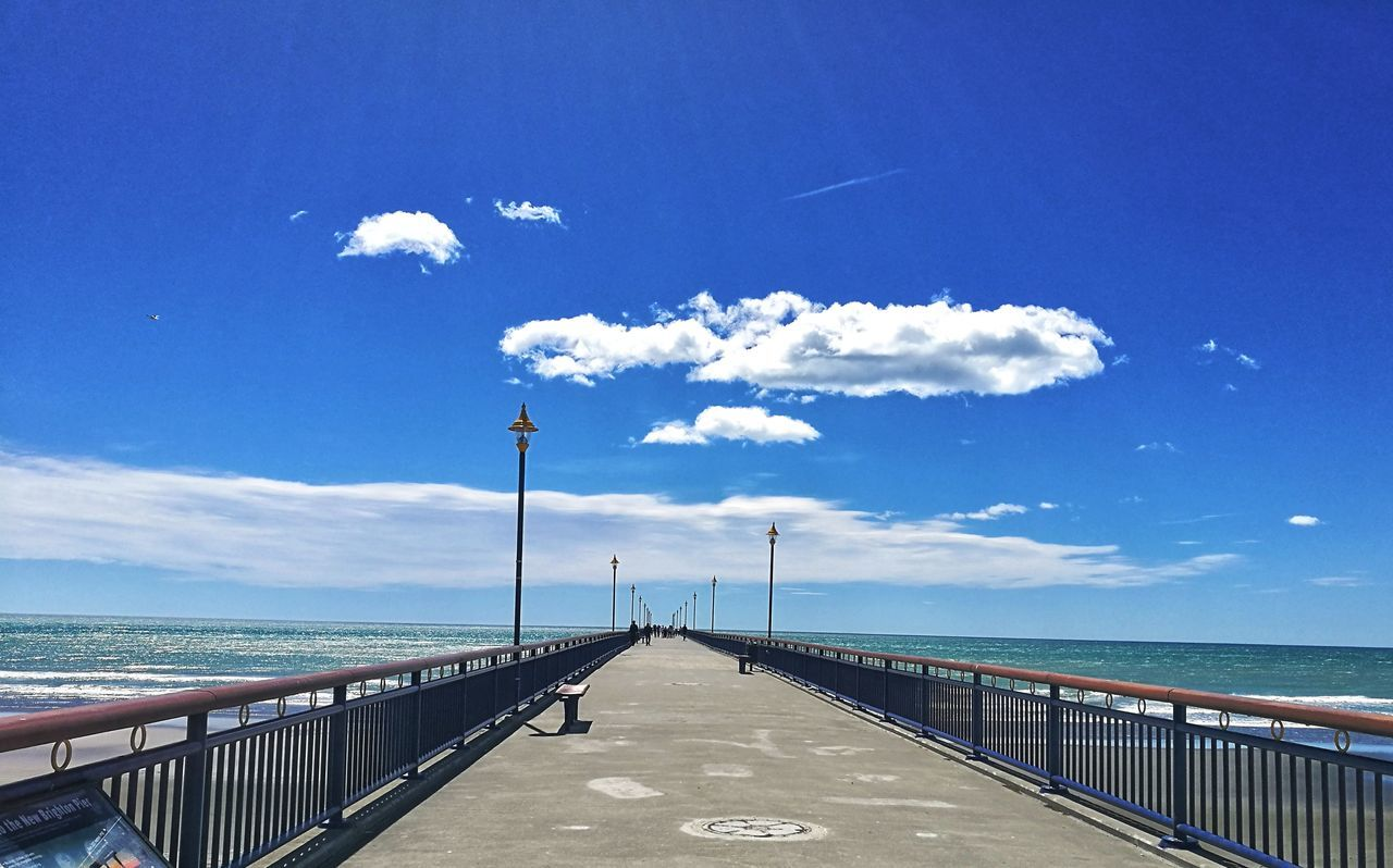 sea, railing, sky, water, blue, scenics, horizon over water, cloud - sky, day, nature, tranquility, the way forward, tranquil scene, beauty in nature, outdoors, beach, no people