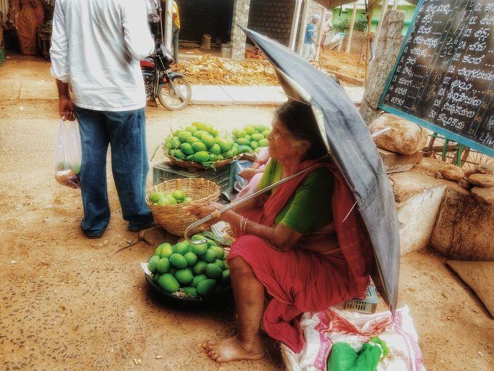 Indian fruit King Of Fruits Mango Market Yardold woman with umbrella The Photojournalist - 2017 EyeEm Awards The Photojournalist - 2017 EyeEm Awards