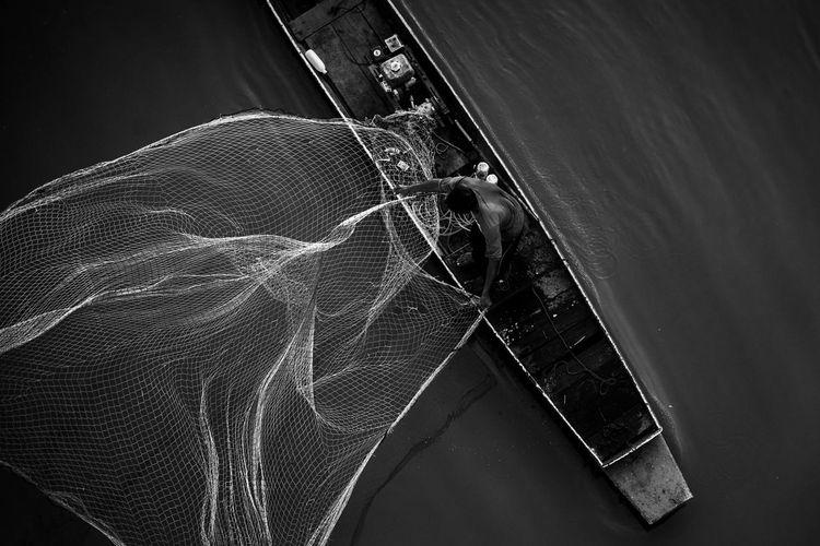 High angle view of fishing net on window