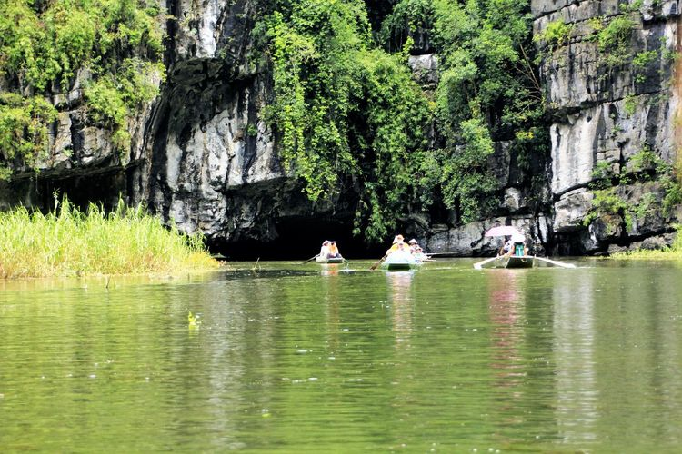 The three caves (Tom Coc) on Ngo Dong River in Vietnam River Water Geology Tom Coc, Viet Nature Mountain Rock Formation Natural Pattern Physical Geography Beauty In Nature Rock - Object Waterfront Travel Destinations Tourism