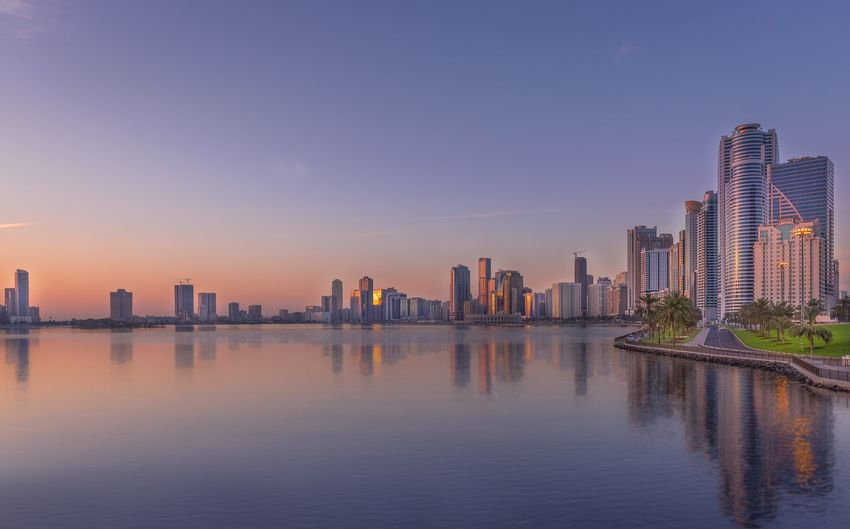 Emirate Of Sharjah By Lake Against Sky During Sunset