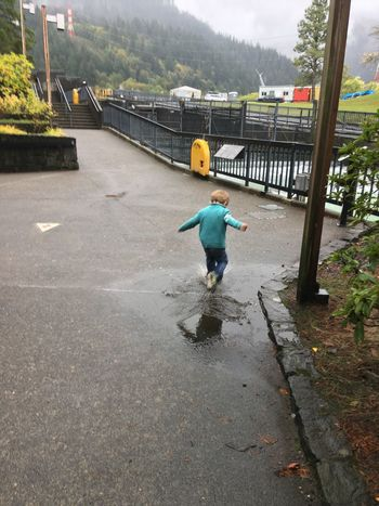 Splash in a puddle on a rainy day can make a child happy. Happy Happy People Happiness Puddle Puddles Splashing Splash Puddle Jumping Puddle Jumper Bonneville Dam Rainy Days Rain Rainy Day Gray Sky Gray Wet Day