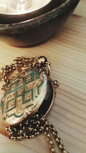 Table Close-up Antique Jewelry Locket Candle Light Precious Metal Scottish Charm Celtic