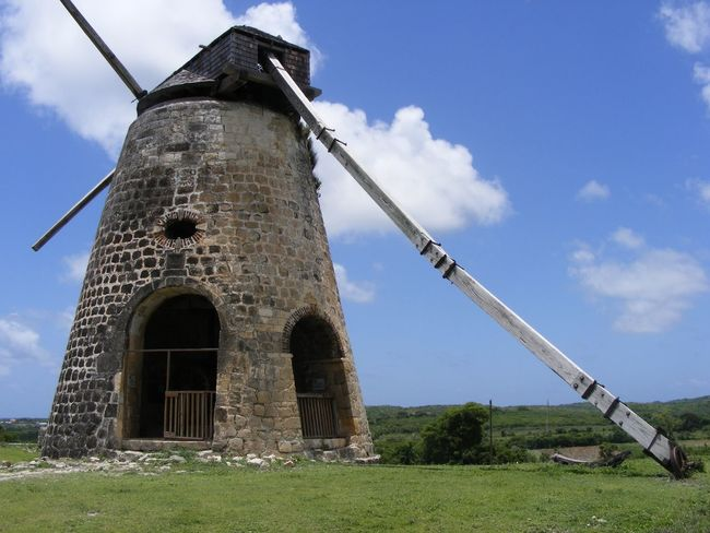 Built Structure Sugar Mill Architecture Low Angle View Sky Building Exterior No People Fuel And Power Generation Wind Power Renewable Energy Day Outdoors Alternative Energy Wind Turbine Windmill Technology Abandoned Old Buildings Disused Building