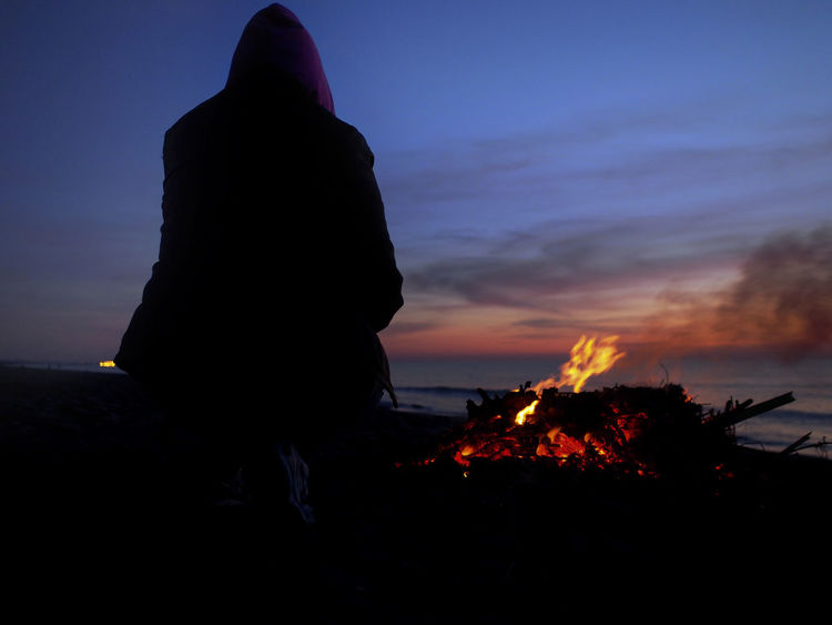 Landascape Beauty In Nature Bonfire Burning Flame Full Length Landascapephotography Leisure Activity Nature Notte One Person Outdoors People Real People Sea Sky Sunset Tramonti_italiani