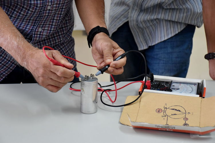 Midsection Of Engineer Testing Wires