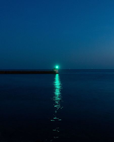 Everything's calm Finistere Brittany Lighthouse Water Reflection Scenics - Nature Sea Nature Beauty In Nature No People Waterfront Illuminated Sky Night Tranquil Scene Tranquility Blue Idyllic Outdoors Lighting Equipment Travel The Creative - 2018 EyeEm Awards