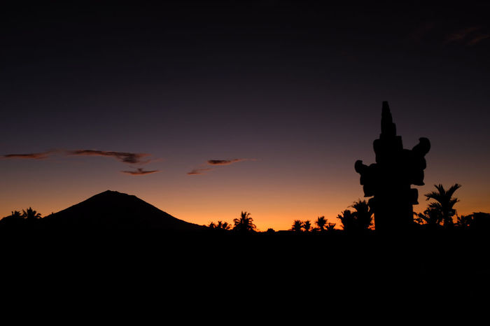 Mount Agung Bali - The Sleeper Awakens. The Indonesian authorities raised alert levels for Mount Agung, on the resort island of Bali, after hundreds of tremors stoked fears it could erupt for the first time since 1963, when it killed more than 1,000 people. News source: NYT 20 September 2017. Bali Blue Hour Copy Space INDONESIA Active Volcano Beauty In Nature Dawn Documentary Journalism Landscape Mountain Nature News Flash  Orange Color Outdoors Reportage Scenics Seismic Activity Silhouette Sky Sunset Tranquility Travel Warning Mount Agung