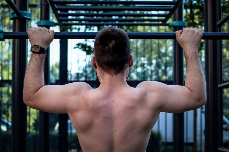 Rear view of shirtless man