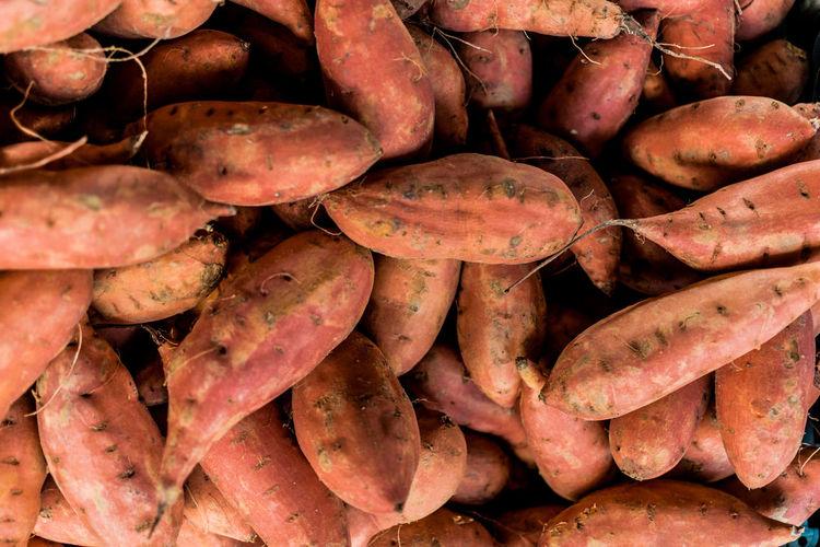 Full frame shot of sweet potatoes for sale at market