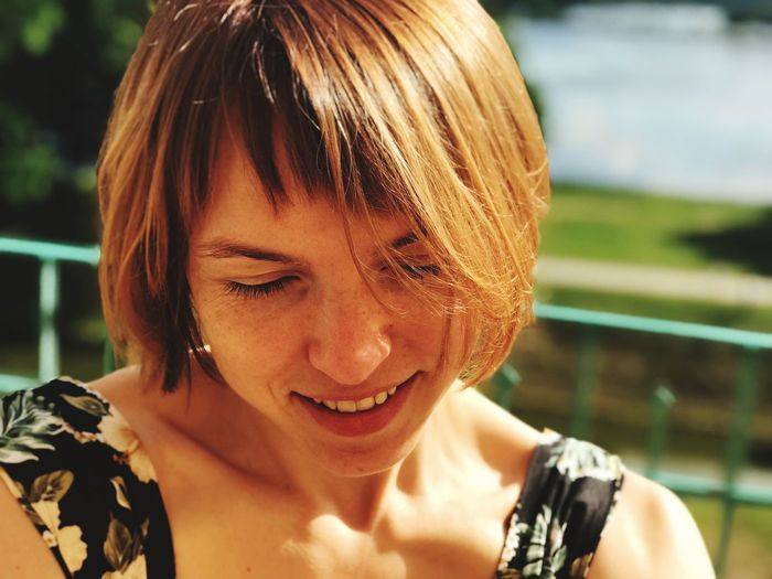 Close-Up Of Smiling Mid Adult Woman During Sunny Day