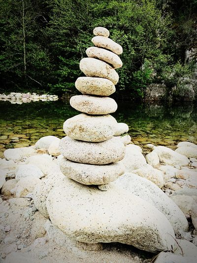 Stain near a river in Corsica IPhone Photography Calm Symbol Zen-like Resting Tranquil Scene IPhone Photography IPhoneography Yoga Zen Stack Sunlight Balance Nature Stone - Object Day Zen-like Stone Outdoors Tranquility Solid No People Rock