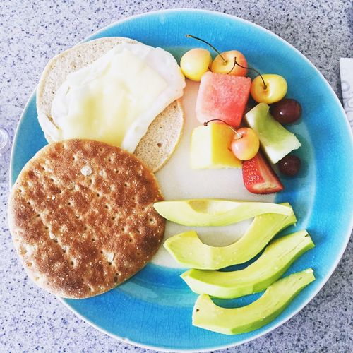 Time For Breakfast  Fresh Fruits, avocado, Egg & cheese on flat wheat bread.... Yummy!