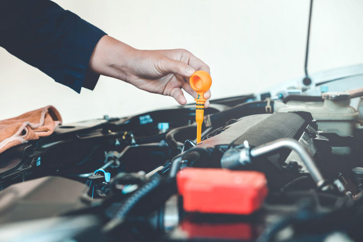 Auto Repair Shop Car Close-up Day Holding Human Body Part Human Hand Indoors  Land Vehicle Manual Worker Men Mode Of Transport Occupation One Person People Real People Transportation