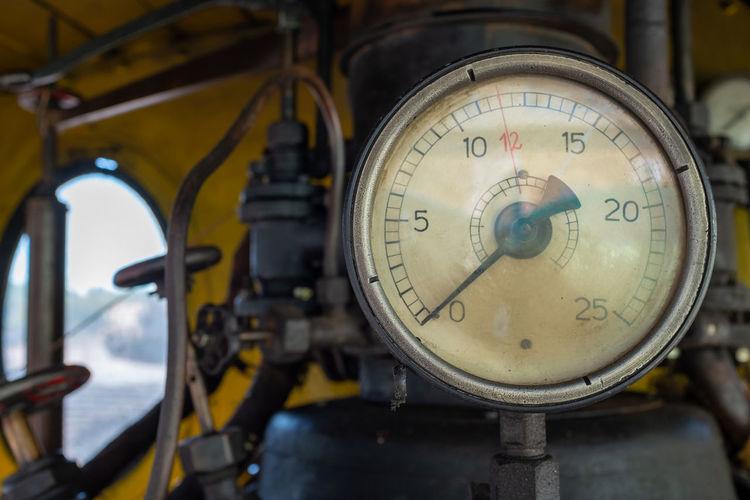 Close-up of machine part in train