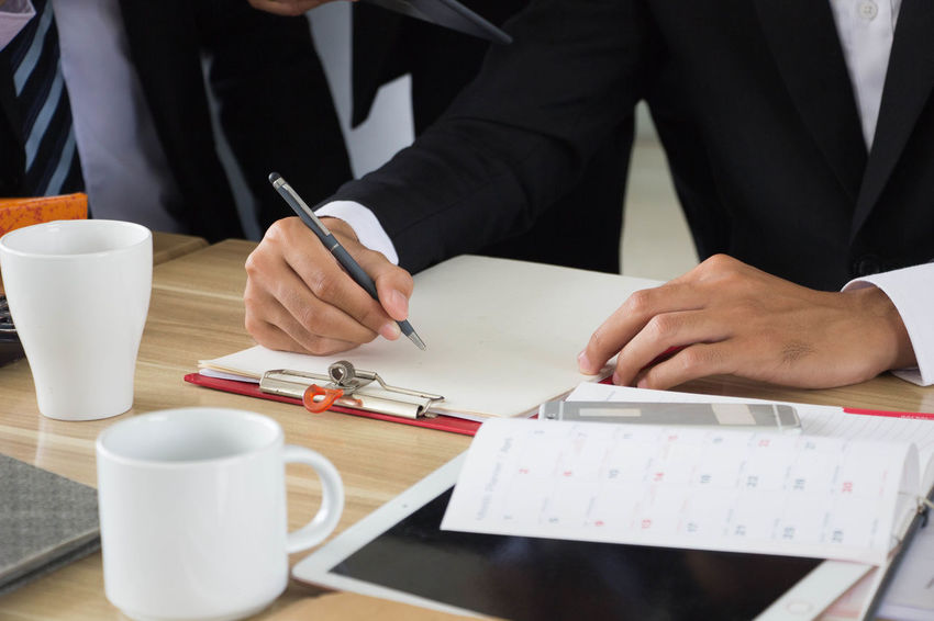 Achievement Broker Business Coffee Hanging Out Meeting Office Suit Accountant Advisor Boss Business Finance And Industry Businessman Businesswoman Documentary Finance Indoors  Manager Men Paper Pen Signature Table Working Writing