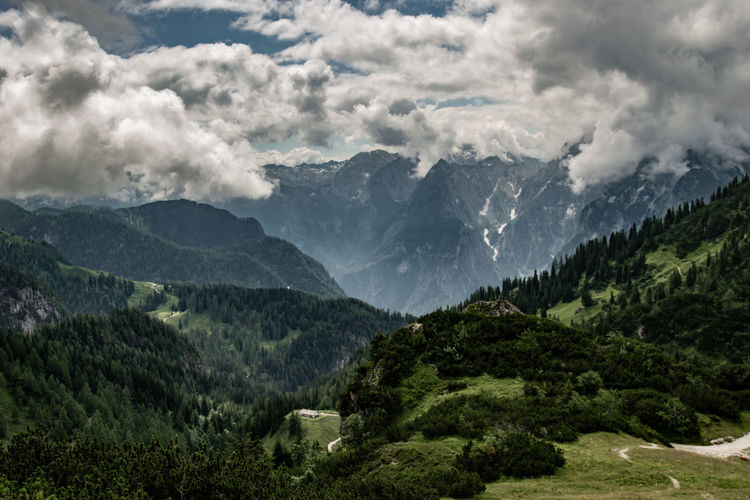 Scenic view of mountains against sky - hiking in the alps